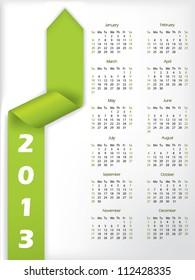 2013 calendar with arrow shaped green ribbon