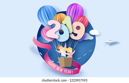 2019 New Year design card with kids in round hole on blue background. Vector paper art illustration. Paper cut and craft style.