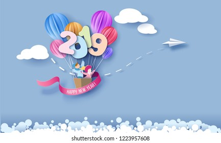 2019 New Year design card with kids with air balloons on blue sky background. Vector paper art illustration. Paper cut and craft style.