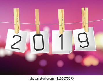 2019 on paper hanging on the clothesline.