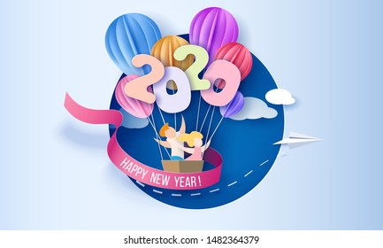 2020 New Year design card with kids in basket of air balloons flying on blue sky hole background. Vector paper art illustration. Paper cut and craft style.
