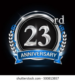 23rd silver anniversary logo with blue ribbon and ring.
