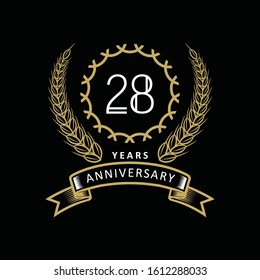 28th anniversary logo with gold and white frame and color. on black background