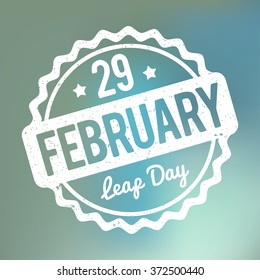 29 February Leap Day rubber stamp white on a blue bokeh fog background.