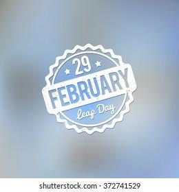 29 February Leap Day rubber stamp white on a light blue bokeh fog background.