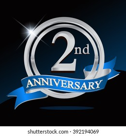 2nd anniversary logo with blue ribbon and silver ring, vector template for birthday celebration.