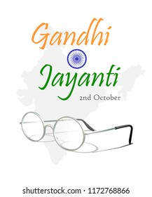 2nd October. Gandhi Jayanti. An inscription in the form of Indian flag with ashoka chakra and eyeglasses over silhouette of the map of India. Vector illustration.