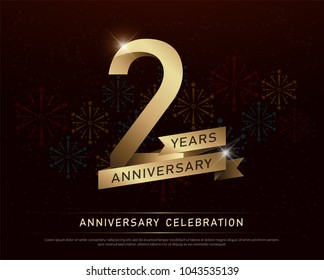 2nd years anniversary celebration gold number and golden ribbons with fireworks on dark background. vector illustration