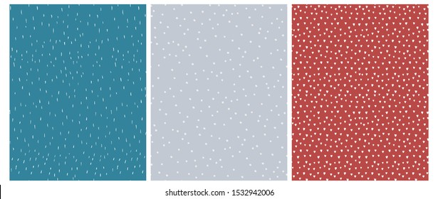 3 Cute Abstract Geometric Vector Patterns.White, Blue and Red Color Design. Brushed Raindrops on a Blue Background. Irregular White Dots on a Gray. Romantic Print With White Hearts Isolated on a Red.