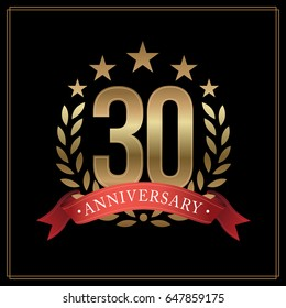 30 years golden anniversary logo, with star, red ribbon, and  laurel wreath isolated on black background, vector design
