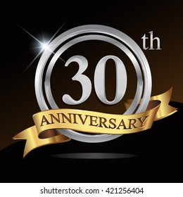 30th anniversary logo, with shiny silver ring and gold ribbon isolated on black background. vector design for birthday celebration.