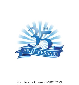 35th anniversary ribbon logo with blue rays of light