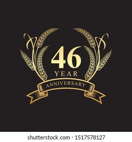 46th golden anniversary logo with ring and ribbon, laurel wreath vector design isolated on black background