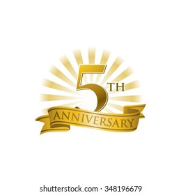5th anniversary ribbon logo with golden rays of light