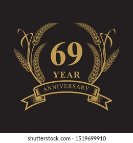 69  golden anniversary logo with ring and ribbon, laurel wreath vector design isolated on black background