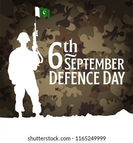 6th September. Happy Defence Day. Pakistani soldier standing and wearing Helmet and holding Rifle flag with english calligraphy on army background