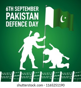 6th September Happy Defence Day Pakistani soldier holding flag and wearing Helmet and handing Rifle with english calligraphy on green background with  barbed wire