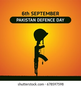 6th Septermber. Happy Defence Day. Rifle and Helmet of vetern on orange and yellow sunset background