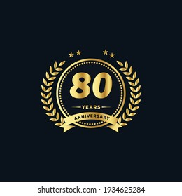 80th golden anniversary logo, with shiny ring and golden ribbon, laurel wreath isolated on navy blue background