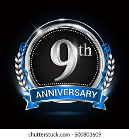 9th silver anniversary logo with blue ribbon and ring.