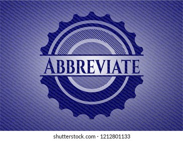 Abbreviate badge with denim background