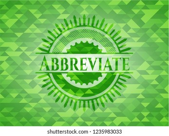 Abbreviate green emblem with mosaic background