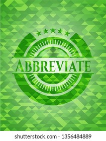 Abbreviate green emblem with triangle mosaic background