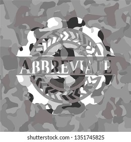 Abbreviate on grey camouflaged pattern