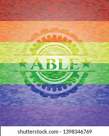 Able emblem on mosaic background with the colors of the LGBT flag