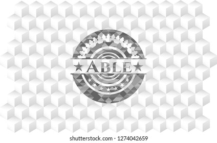 Able grey badge with geometric cube white background