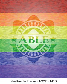 Able on mosaic background with the colors of the LGBT flag