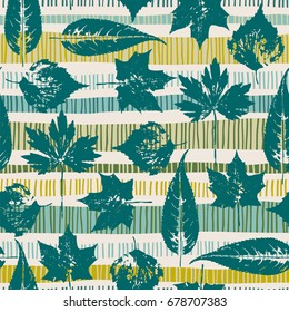 Abstract autumn seamless pattern with leaves on geometric background. Vector template for various surface. Trendy hand drawn textures.