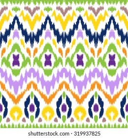 Abstract background. Colorful Ikat seamless pattern for textile, wallpaper, card or wrapping paper.