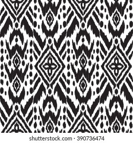 Abstract background in the ethnic style. Black and white Ikat seamless pattern for textile, wallpaper, card or wrapping paper.