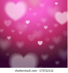 Abstract Background with pink and white blured hearts.