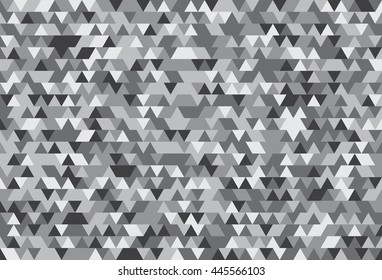 Abstract background of the triangles. The gradation of gray. Gray hues.