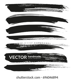 Abstract black thick vector brush strokes isolated on a white background