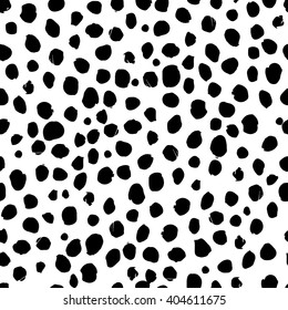Abstract black and white polka dot seamless pattern Vector. Chaotic seamless black blobs or uneven spots on white isolated background. Hand drawn spotted texture. Grunge background. Spots Set Vector