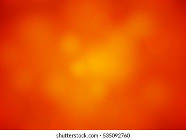 Abstract Blur Red Orange colored Background with Shine Light. Blurry soft rubicund elegant Wallpaper.