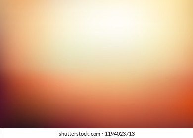 Abstract blurred background in golden orange and yellow tones. Autumn colors vector illustration. Sunset scene color gradient