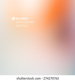 abstract blurred background with orange, beige and gray stains