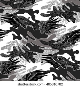 Abstract camouflage seamless pattern. Trendy fabric design in black and white colors. Wings and splashes.