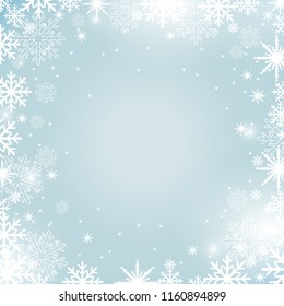 Abstract Christmas background with snowflakes and lights on blue backdrop
