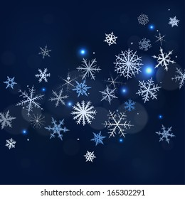 Abstract Christmas background with various snowflakes.