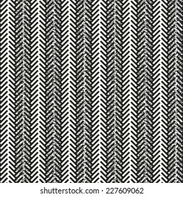 Abstract decorative herringbone stroke with noisy elements. Seamless pattern. Vector.