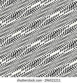 Abstract diagonal organic herringbone motif. Seamless pattern.