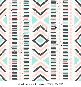 Abstract geometric seamless pattern in pastel colors. Ethnic decorative art in pink, blue and gray. Indian style repeat pattern.