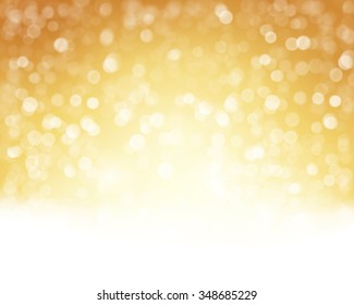 Abstract golden white background with blurry lights that give it a magical feeling as a backdrop for the Christmas season or any festive occasion.
