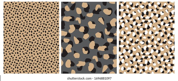 Abstract Leopard Skin Seamless Vector Patterns. White, Brown and Black Irregular Brush Spots on a Gray and Gold Backgrounds.  Abstract Wild Animal Skin Print. Simple Irregular Geometric Design.