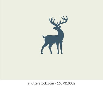 Abstract logo icon deer silhouette with big horns for your company